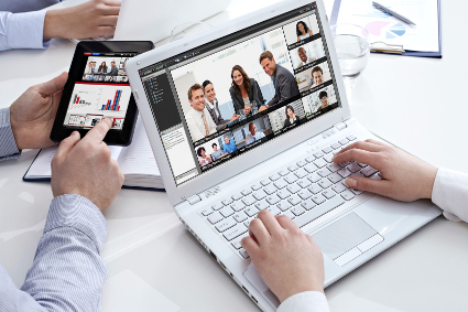 Workplace of three colleagues working together
